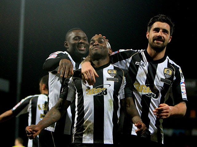 Notts County's Jamal Campbell-Ryce is congratulated by team mates after scoring his team's fourth against Bury on February 22, 2013