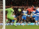 United striker Javier Hernandez heads the second goal against Reading on February 18, 2013