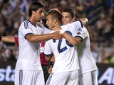 Real Madrid's Jese Rodriguez celebrates with teammates after scoring against the Los Angeles Galaxy in a friendly match on August 2, 2012