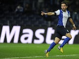 Porto's Joao Moutinho celebrates a goal against Malaga on February 19, 2013