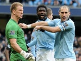 City players congratulate Joe Hart after his penalty save against Chelsea on February 24, 2013