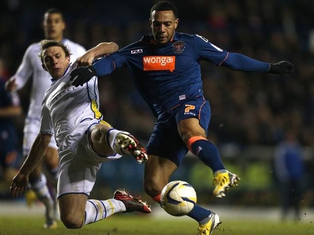 Leeds United's Stephen Warnock and Blackpool's Matt Phillips battle for the ball on February 20, 2013