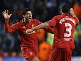 Liverpool's Luis Suarez celebrates with team mate Jose Enrique after scoring his team's third against Zenit St Petersburg on February 21, 2013