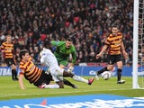 Swansea winger Nathan Dyer slides home the opening goal in the Capital One Cup final against Bradford on February 24, 2013