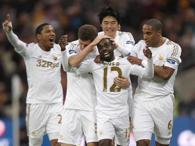 Swansea players congratulate Nathan Dyer after his goal against Bradford on February 24, 2013