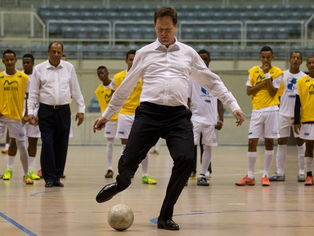 Deputy Prime Minister Nick Clegg kicks a ball during a visit to Brazil on June 21, 2012