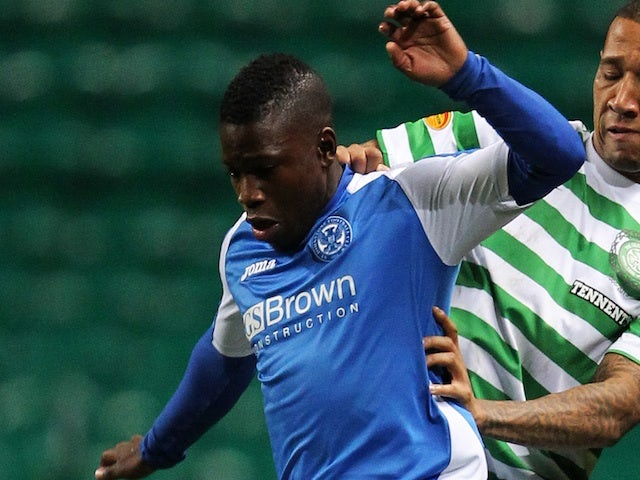 St Johnstone's Nigel Hasselbaink in action against Celtic on October 30, 2012