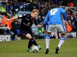 Birmingham City's Chris Burke tries to get past Peterborough United's Joe Newell on February 23, 2013