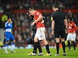 Man Utd defender Phil Jones leaves the field injured against Reading on February 18, 2013