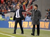 Managers Phil Parkinson and Michael Laudrup on the touchline during the Capital One Cup final between Bradford and Swansea on February 24, 2013