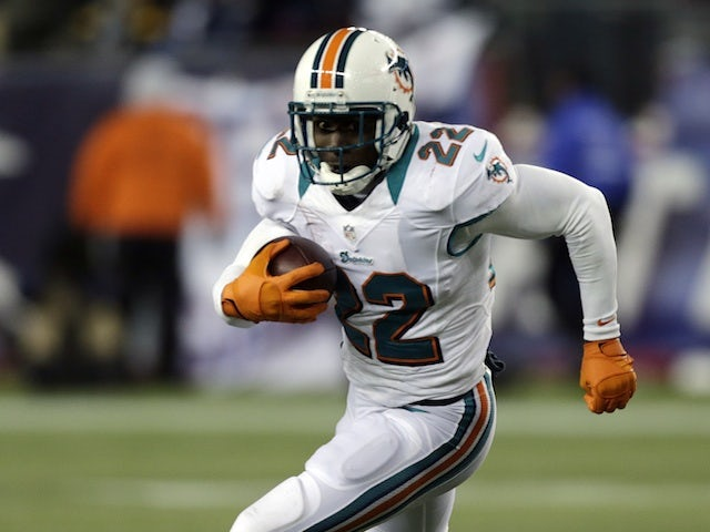 Dolphins RB Reggie Bush in action against New England on December 30, 2012
