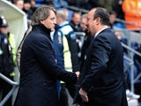 Opposing bosses Roberto Mancini and Rafa Benitez shake hands before the Man City v Chelsea match on February 24, 2013