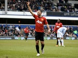 Ryan Giggs celebrates a goal for United against QPR on February 23, 2013