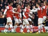 Arsenal players congratulate Santi Cazorla after a goal against Aston Villa on February 23, 2013