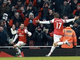 Arsenal's Santi Cazorla celebrates his second goal against Aston Villa with Nacho Monreal on February 23, 2013