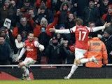 Arsenal's Santi Cazorla celebrates his second goal against Aston Villa with Nacho Monreal on February 23, 2013