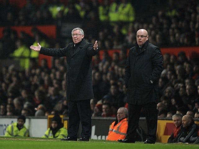Opposing bosses Sir Alex Ferguson and Brian McDermott on the touchline on February 18, 2013