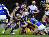 Melbourne Storm's Sisa Waqa is tackled by Leeds Rhino's Brett Delaney on February 22, 2013