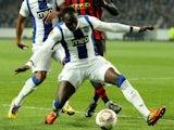 Porto's Eliaquim Mangala holds of Manchester City's Mario Balotelli on February 16, 2012