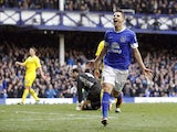 Everton's Kevin Mirallas celebrates scoring his side's third goal against Reading on March 2, 2013