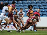 Huddersfield's Joe Wardle dives over for a try against Bradford Bulls on March 3, 2013