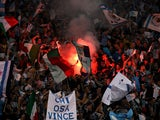 Lazio's fans let off a flare before the game against Real Madrid on October 3, 2007
