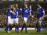 Everton's Leighton Baines is congratulated by team mates after scoring his team's second in the FA Cup 5th round replay against Oldham on February 26, 2013