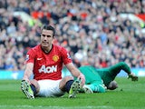 Manchester United's Robin van Persie reacts after missing a chance against Norwich on March 2, 2013