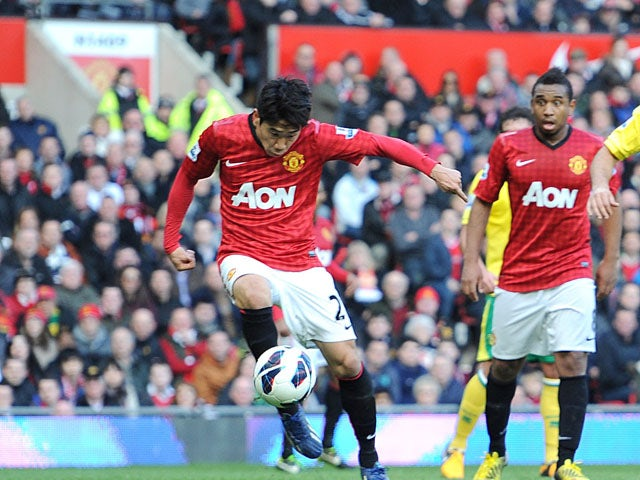 0b1e86b5e Manchester United s Shinji Kagawa shoots to score the opening goal against  Norwich on March 2