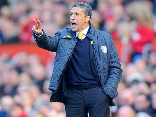 Norwich City manager Chris Hughton gives instructions on the touchline during his side's match against Manchester United on March 2, 2013
