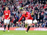 Manchester United's Wayne Rooney scores his side's fourth goal against Norwich on March 2, 2013