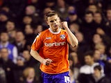 Oldham's Matt Smith celebrates after scoring in the FA Cup 5th round replay against Everton on February 26, 2013