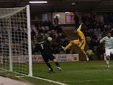 Motherwell's Michael Higdon scores his side's second goal against Celtic on February 27, 2013