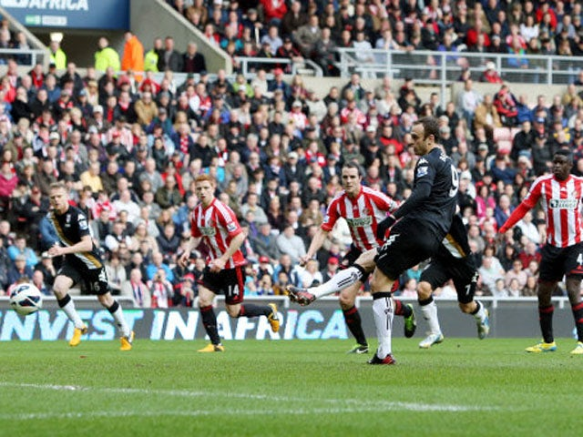 Fulham's Dimitar Berbatov scores a penalty against Sunderland on March 2, 2013