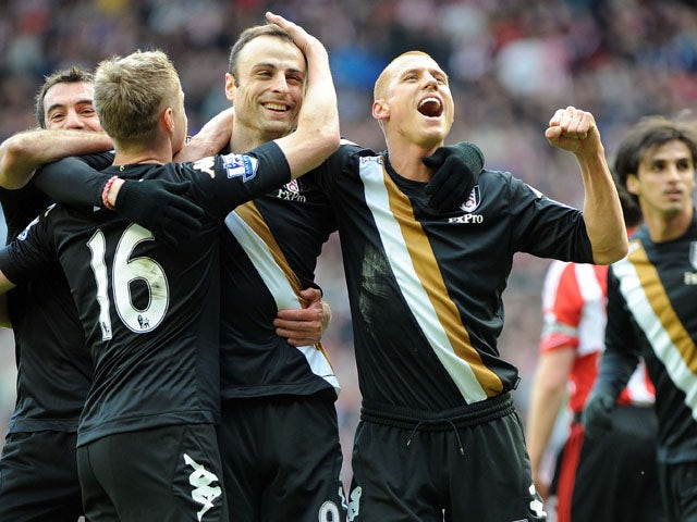 Fulham players celebrate with goalscorer Dimitar Berbatov after he converted a penalty kick against sunderland on March 2, 2013