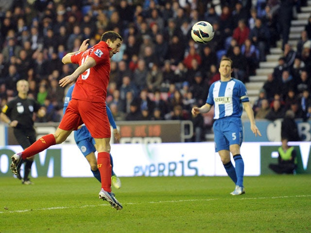 Liverpool's Stewart Downing scores for his side in their game against Wigan on March 2, 2013