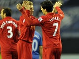 Liverpool's Luis Suarez celebrates scoring his first goal against Wigan on March 2, 2012