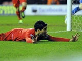 Luis Suarez celebrates scoring a hat-trick for Liverpool in their match against Wigan on March 2, 2013