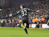 City's Carlos Tevez celebrates his goal against Aston Villa on March 4, 2013