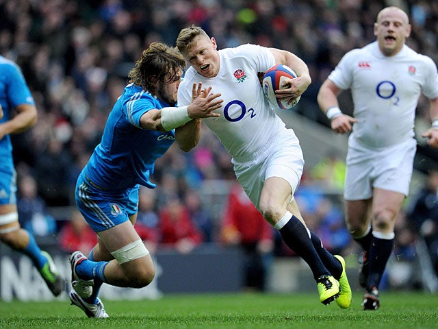 England's Chris Ashton is tackled by Italy's Joshua Furno on March 10, 2013