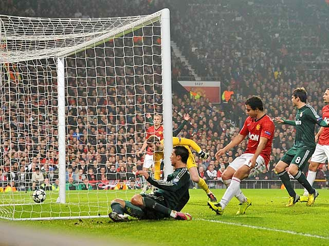 Real Madrid's Cristiano Ronaldo scores his team's second against Manchester United on March 5, 2013
