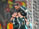 Real Madrid's Cristiano Ronaldo is congratulated by team mates after scoring against Manchester United on March 5, 2013