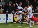 Wakefield Wildcats' Dean Collis goes over to score a try against Salford City Reds on March 10, 2013