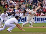 New Zealand's Hamish Rutherford hits a shot past England's Alastair Cook on March 8, 2013
