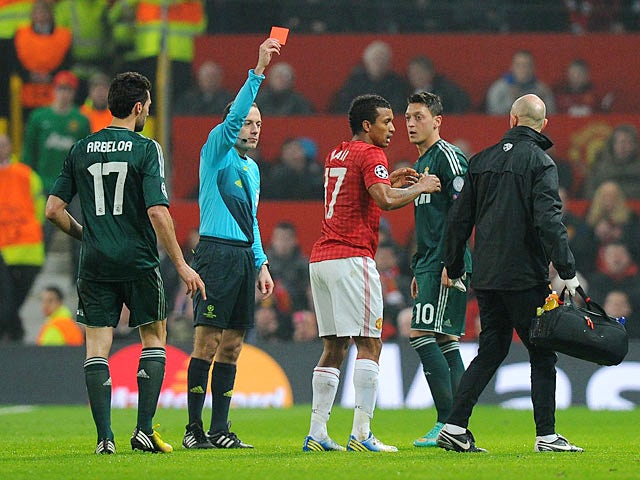 Manchester United's Nani is shown a red card during the second half against Real Madrid on March 5, 2013