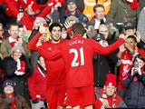 Luis Suarez is congratulated by team mate Lucas after scoring the opener against Spurs on March 10, 2013