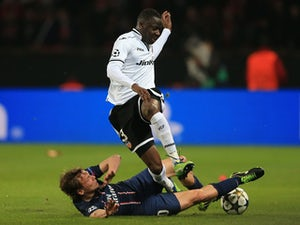 Paris Saint-Germain's Clement Chantome and Valencia's Aly Cissokho battle for the ball on March 6, 2013