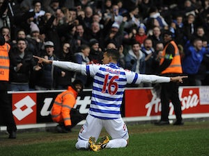 QPR's Jermaine Jenas celebrates after scoring his side's third goal against Sunderland on March 9, 2013