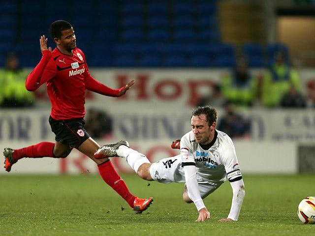 Derby's Richard Keogh is fouled by Cardiff's Fraizer Campbell on March 5, 2013