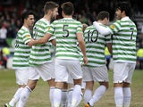 Celtic players celebrate with goalscorer Charlie Mulgrew after his goal against Ross County on March 9, 2013